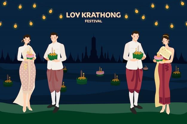 Schwimmende blumen des thailändischen paartraditionskostüms loy kratong thailand-festivalvollsupermondnacht und tempelszenenfeier