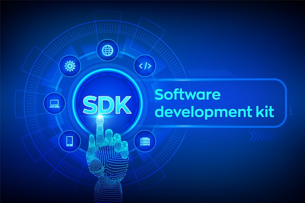 Sdk. software development kit-konzept auf virtuellen bildschirm. roboterhand, die digitale schnittstelle berührt.