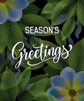Seasons Greetings Schriftzug mit dunklen Blättern und Blumen.