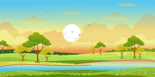 Seeblick mit sonnenaufgang im flachen hintergrund der grünen wiesen