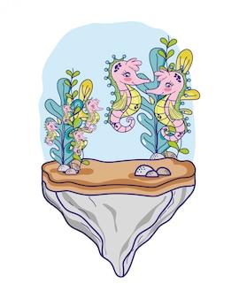 Seepferdefamilientiere im stein mit meerespflanzenanlagen