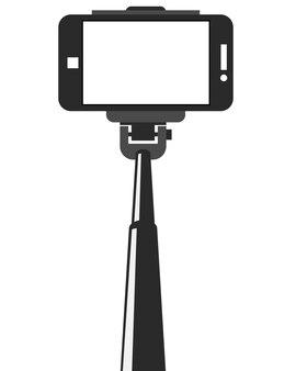 Selfie-stick und smartphone mit leerem bildschirm