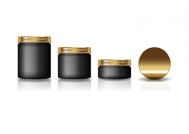 Set aus 3 runden schwarzen kosmetikgläsern mit goldenem deckel.