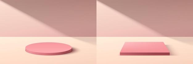 Set aus abstraktem 3d-rosa-zylinder- und würfelpodest-podium mit pastellrosa wandszene im schatten