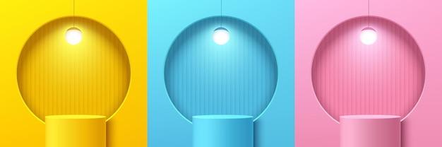 Set aus abstraktem gelbrosa und blauem zylinderständerpodium mit kreisfenster und kugelhängelampe