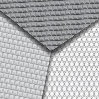 Set aus mehreren nahtlosen kohlefasermustern in schwarzen und grauen farben