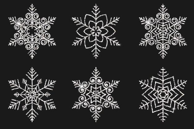 Set aus silbrigen schneeflocken für design