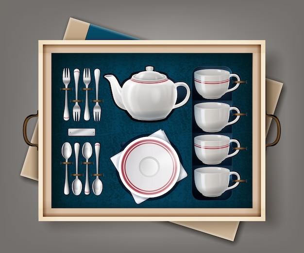 Set aus weißem porzellan für tee oder kaffee und besteck in einer tasche