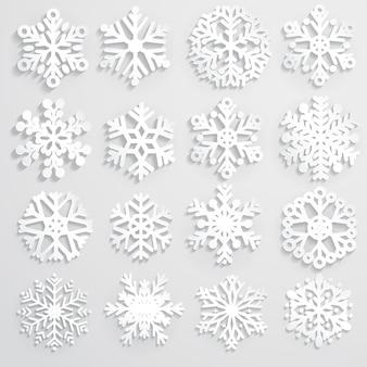 Set aus weißen schneeflocken verschiedene formen aus papier, mit schatten