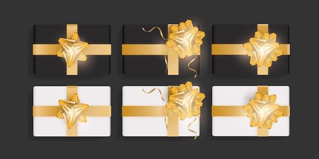 Set aus weißen und schwarzen geschenkboxen mit goldenen schleifen. schöne realistische geschenkboxschablone für geburtstag, weihnachten, design des neuen jahres. draufsichtvektorillustration
