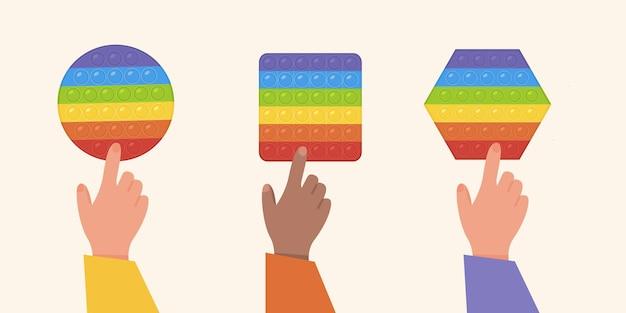 Set beliebter pop-it-zappel-kinder, die mit regenbogenfarbenen anti-stress-spielzeugillustrationen spielen