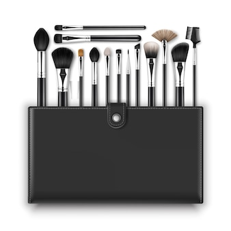 Set black clean professional makeup concealer puder rouge lidschatten augenbrauenbürsten mit schwarzen griffen und ledertasche isoliert