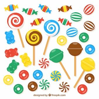Set bunte süßigkeiten in der flachen art