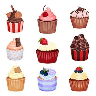 Set cupcakes mit verschiedenen dekorationen und cremes
