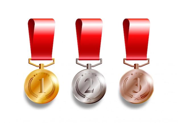 Set mit 3 realistischen medaillen, gold, silber und bronze mit roten bändern