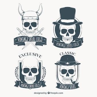 Set schädel-logos mit hand gezeichneten bänder