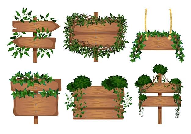 Set tropischer lianenholzbretter mit isolierten bildern von schildern, die von weinblättern umwickelt sind wrapped