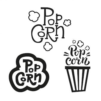 Set von 3 popcorn-text-etiketten in verschiedenen stilen. handgezeichnete typografie zeichen. sammlung des schwarzen weißen logos.