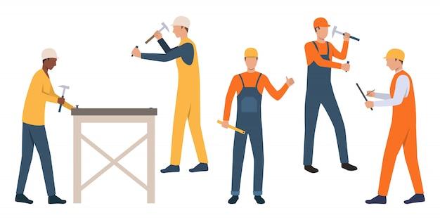 Set von arbeitern in schutzhelmen