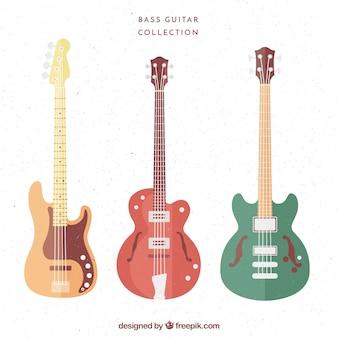 Set von bassgitarren in pastellfarben