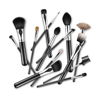 Set von black clean professional makeup concealer puder rouge lidschatten augenbrauenbürsten mit schwarzen griffen chaotisch verstreut isoliert