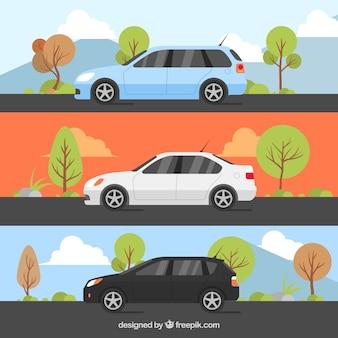 Set von drei dekorativen autos mit verschiedenen landschaften