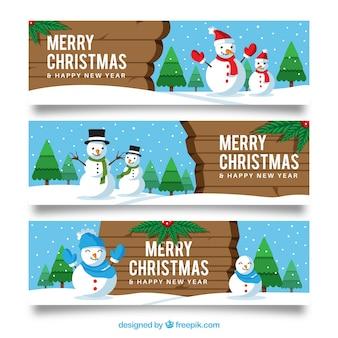 Set von drei weihnachtsfahnen mit schneemännern