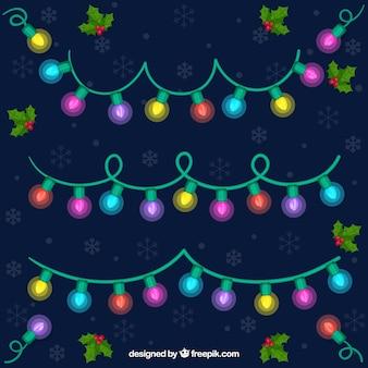 Set von glühenden weihnachtsbeleuchtung
