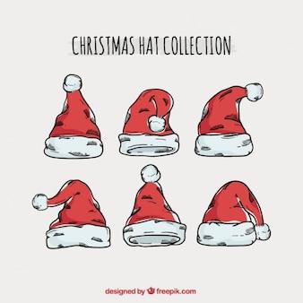 Set von hand gezeichnet weihnachtsmann-hüten
