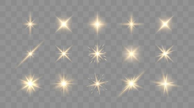 Set von leuchtenden funkeln und lens flares leuchtenden lichtern isoliert auf transparentem hintergrund