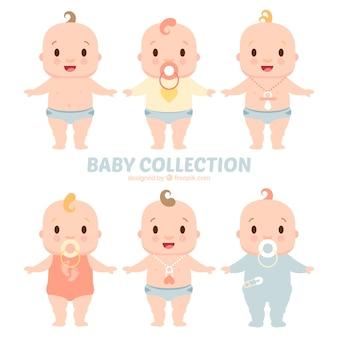 Set von niedlichen babys mit schnuller