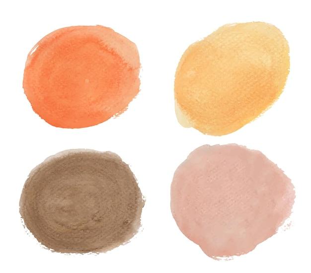 Set von orange und braun. runde aquarellspritzer. kreiselemente Premium Vektoren