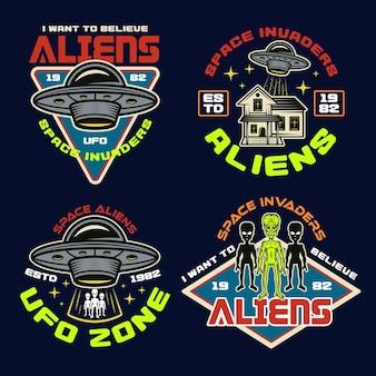 Set von vektor-aliens und ufo-farbigen vektoremblemen, etiketten, abzeichen, aufklebern oder t-shirt-drucken im vintage-stil auf dunklem hintergrund