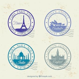 Set von vier runden briefmarken mit verschiedenen städten