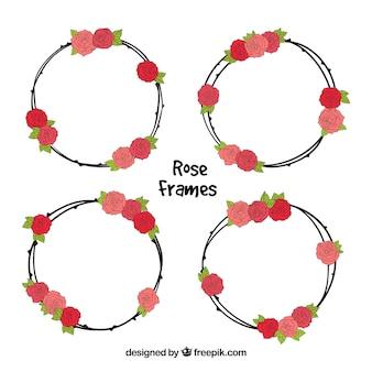 Set von vier runden rahmen mit handgezeichneten rosen