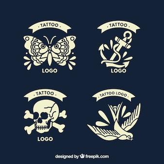 Set von vier tattoo-stil logos im vintage-stil