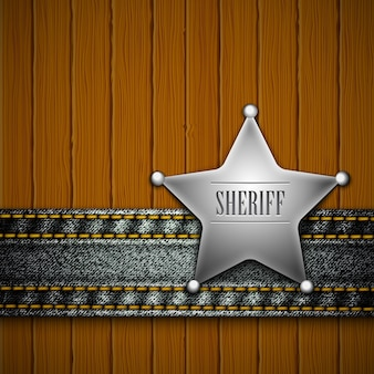 Sheriff's badge mit denim-element auf einem holz