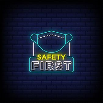 Sicherheit erste leuchtreklame stil text mit gesichtsmaske symbol