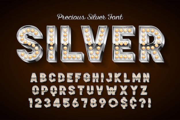 Silberne 3d-schrift mit edelsteinen, goldenen buchstaben und zahlen.