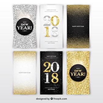 Silberne und goldene Karten des neuen Jahres 2018 mit Funkeln