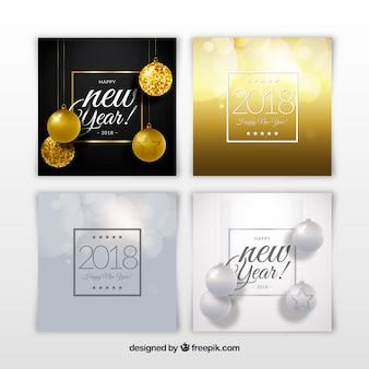 Silberne und goldene karten des neuen jahres 2018 mit weihnachtsbällen