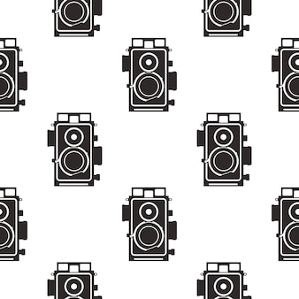 Silhouette altes kameramuster. vintage-kameras im monochromen stil, geometrische nahtlose tapeten für textildrucke, bekleidung, t-shirts usw. stock vektor retro-stil hintergrund isoliert auf weiss.