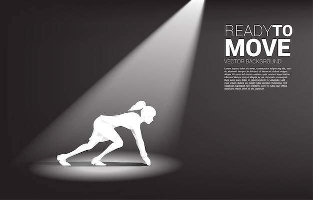 Silhouette der geschäftsfrau bereit, im scheinwerferlicht zu laufen. konzept von menschen, die bereit sind, karriere und geschäft zu beginnen
