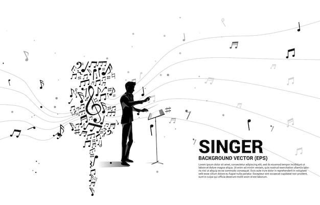Silhouette des dirigenten mit schallwellenmikrofon aus musiknotenmelodietanz.
