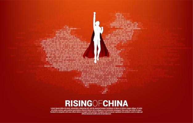 Silhouette des geschäftsmannes, der mit china-karte aus binärem null- und eins-code fliegt. konzept für china digitale währungswirtschaft und finanznetzwerkverbindung.