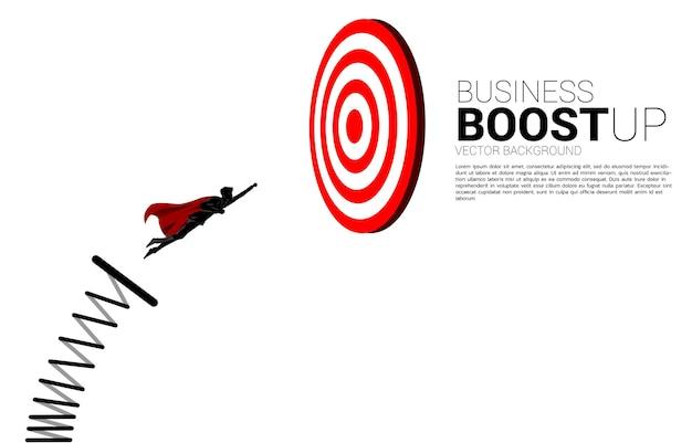 Silhouette des geschäftsmannes, der mit sprungbrett auf die dartscheibe fliegt. business-banner für targeting und kunden.