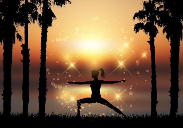 Silhouette einer frau in yoga-pose in tropischen landschaft