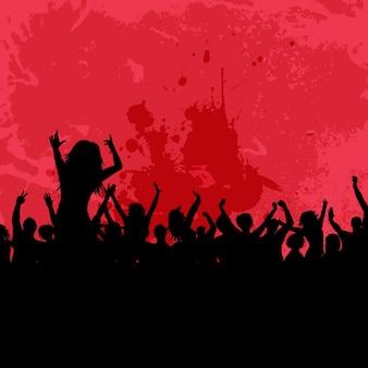 Silhouette einer party-menge auf einem grunge-hintergrund