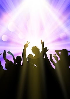 Silhouette einer partymenge unter scheinwerfern