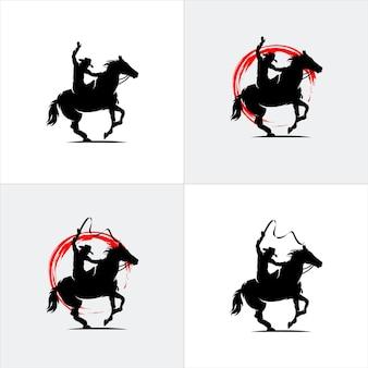 Silhouette eines cowboys, der ein wildes pferdeset reitet